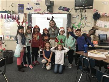 Mrs. Pairan's second grade class celebrated Reindeer and Grinch Day!