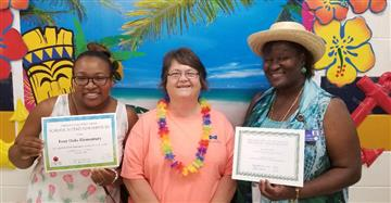 Photos of Cafeteria manager Laura Chavis (center)Keyeria Mitchell (left) and Antenna O