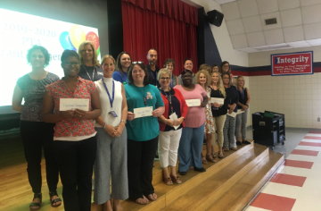 Photo of Mrs. Kathy Parrish and the 2019-2020 FOES PTA grant winners.