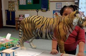student with tiger