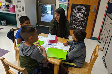 JoCo TEACH  student Vanessa Barbosa helping at West Smithfield Elementary School.