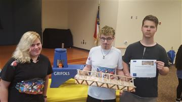 Image of students holding a bridge model