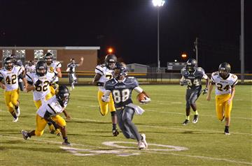 Image of SSS football player running with the football