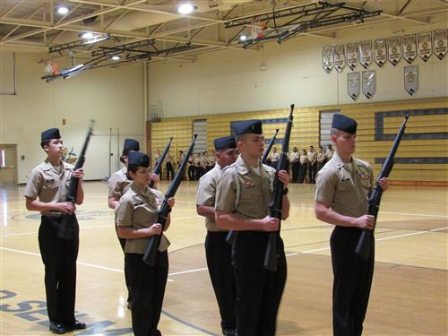 SSS ROTC students using drill purpose rifles