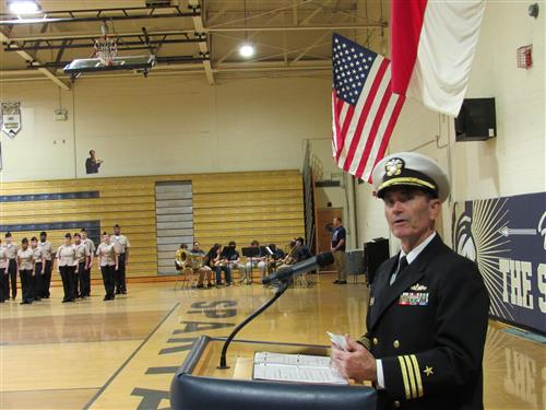 Navy Commander Griffith Jones speaks to the student audience