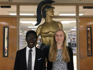 Image of two students standing in front of SSS Spartan statue