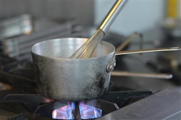 Image of a saucepan on a gas-fired stove