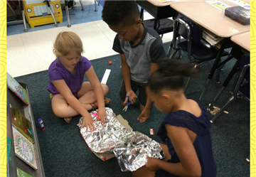 1st Graders are Roasting S'mores with Solar Ovens