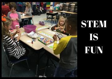 Students in First Grade use STEM Materials for Building