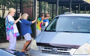 Teachers Waving to a Car