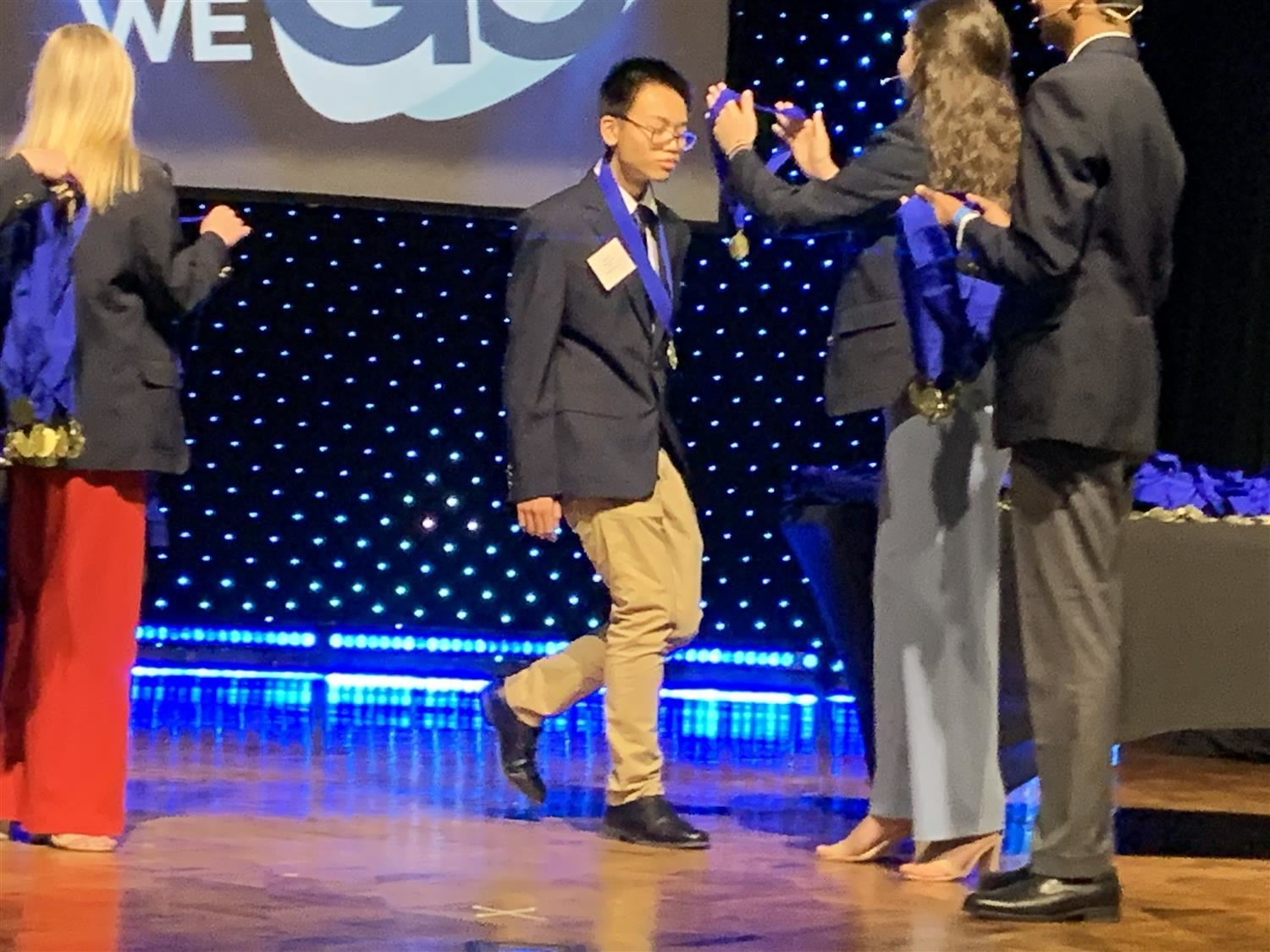 Oscar Liu places first in the accounting event at the DECA State Awards.